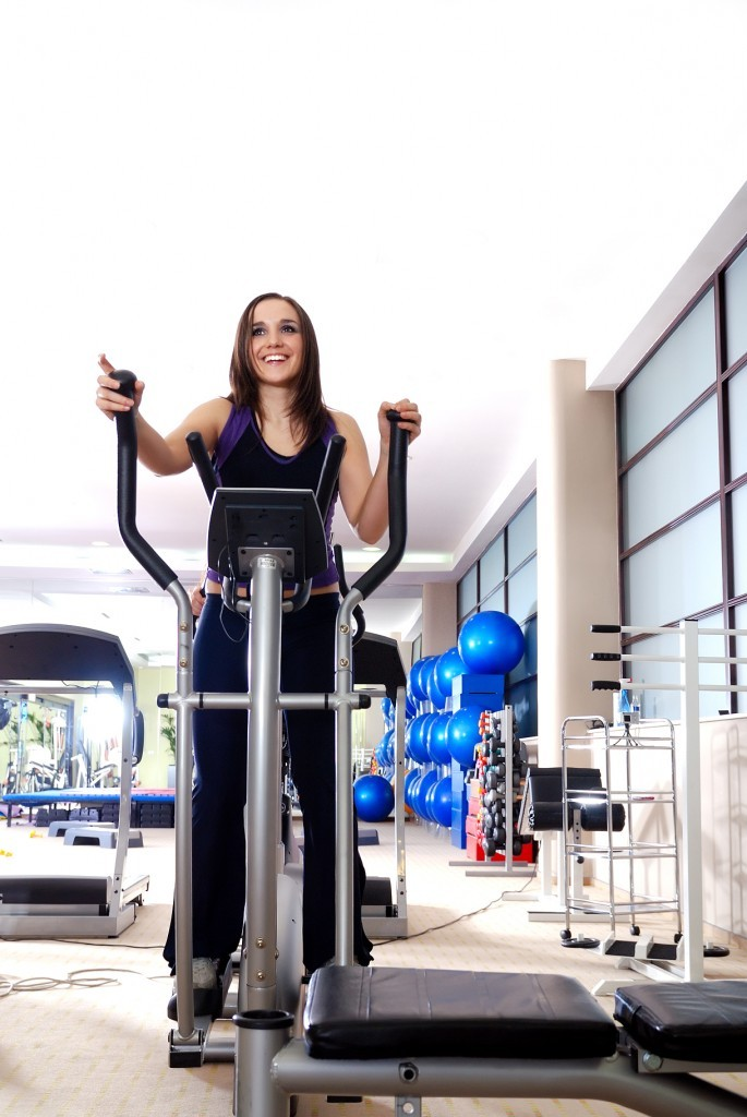 exercise-at-gymnasium-on-static-bicycle-685x1024